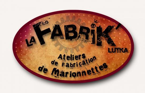 Logo la fabrik lutka atelier de fabrication de marionnettes avec fond couleur site
